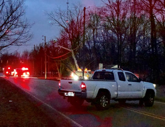 Crews repair a damaged power pole at the intersection of West 79th Street and Township Line Road