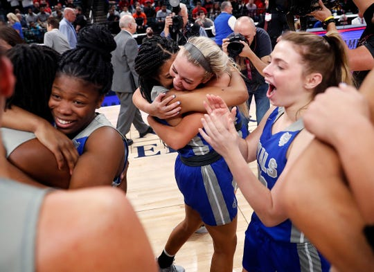 The Hamilton Southeastern Royals celebrate their win over the Lawrence North Wildcats in the IHSAA Girls Basketball Class 4A State Championship game at Bankers Life Fieldhouse on Saturday, Feb 23, 2019. The Hamilton Southeastern Royals  defeated the Lawrence North Wildcats 55-44.