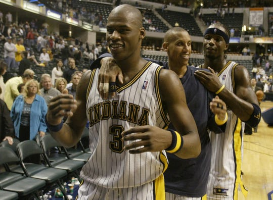 In this 2004 photo, Al Harrington (left) Reggie Miller and Jermaine O'Neal  celebrate as the walk off the court after setting a new wins record for the franchise.