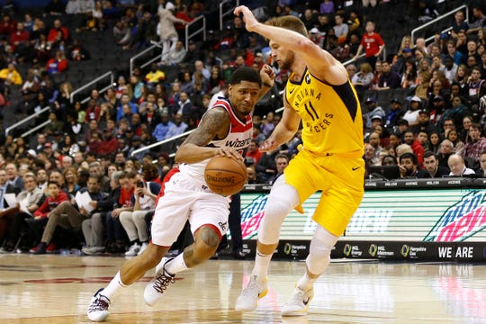 Washington Wizards guard Bradley Beal (3) dribbles the ball as Indiana Pacers forward Domantas Sabonis (11) defends in the fourth quarter at Capital One Arena.