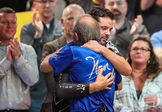 Norm Duke is congratulated by Jason Belmonte as Duke wins the Go Bowling! PBA Indianapolis Open at Woodland Bowl on Sunday, Feb. 24, 2019. Duke earned his 39th career title.