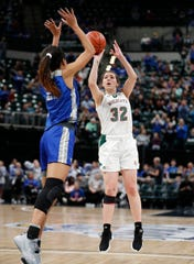 Lawrence North Wildcats Katie Davidson (32) puts up a three-pointer over Hamilton Southeastern Royals Tayah Irvin (21) in the second half of their IHSAA Girls Basketball Class 4A State Championship game at Bankers Life Fieldhouse on Saturday, Feb 23, 2019. The Hamilton Southeastern Royals  defeated the Lawrence North Wildcats 55-44.