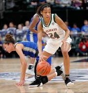 Lawrence North Wildcats Jayla Smith (24) dribbles the ball around Hamilton Southeastern Royals Amaya Hamilton (10) in the first half of their IHSAA Girls Basketball Class 4A State Championship game at Bankers Life Fieldhouse on Saturday, Feb 23, 2019