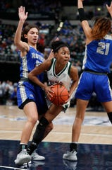 Lawrence North Wildcats Kristian Young (25) looks to pass between Hamilton Southeastern Royals Jackie Maulucci (12) and  Tayah Irvin (21) in the second half of their IHSAA Girls Basketball Class 4A State Championship game at Bankers Life Fieldhouse on Friday, Feb 23, 2019. The Hamilton Southeastern Royals  defeated the Lawrence North Wildcats 55-44.
