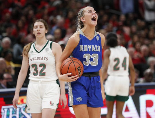 Hamilton Southeastern Royals Sydney Parrish (33) begins to celebrate their win late in the second half of their IHSAA Girls Basketball Class 4A State Championship game at Bankers Life Fieldhouse on Saturday, Feb 23, 2019. The Hamilton Southeastern Royals  defeated the Lawrence North Wildcats 55-44.