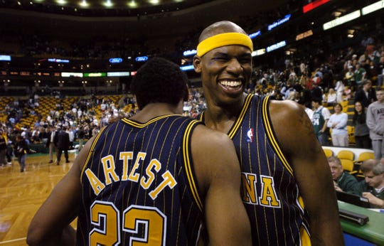 In this 2004 file photo, Al Harrington (right) and Ron Artest celebrate the Pacers 90-75 win over the Boston Celtics to win their first round playoff series.