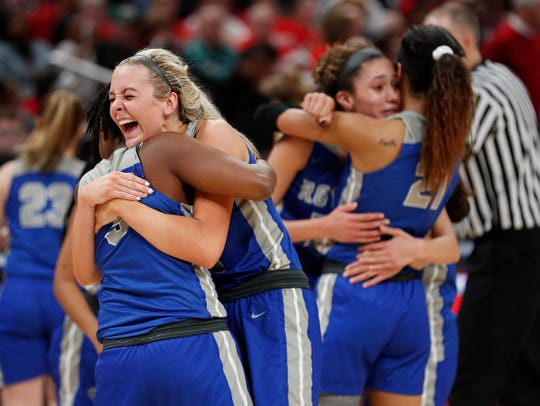 Hamilton Southeastern Royals Sydney Parrish (33) hugs Royals Malea Jackson (3) in the final minutes of the second half of their IHSAA Girls Basketball Class 4A State Championship game at Bankers Life Fieldhouse on Saturday, Feb 23, 2019. The Hamilton Southeastern Royals  defeated the Lawrence North Wildcats 55-44.