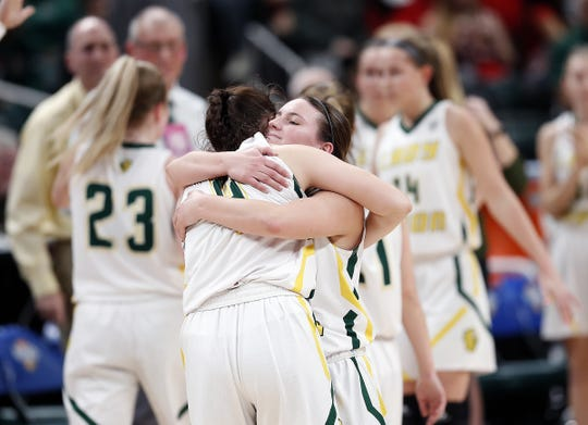 Benton Central Bison Cassidy Minniear (3) hugs Keely Meadows (4) following their IHSAA Girls Basketball Class 3A State Championship game at Bankers Life Fieldhouse on Saturday, Feb 23, 2019. The Northwestern Tigers defeated the Benton Central Bison 61-39.