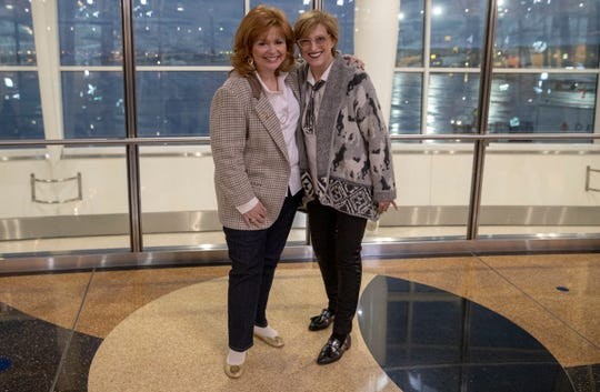Candyce Hayes (left), with her sister, Sherrie Eldridge, moments after meeting for the first time at Indianapolis International Airport on Saturday, Feb. 23, 2019.
