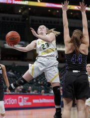 Benton Central Bison Emma Fisher (23) drives around Northwestern Tigers Kendall Bostic (44) in the first half of the IHSAA Girls Basketball Class 3A State Championship game at Bankers Life Fieldhouse on Saturday, Feb 23, 2019.