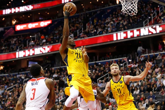 Indiana Pacers forward Thaddeus Young (21) shoots the ball as Washington Wizards guard Bradley Beal (3) looks on in the second quarter at Capital One Arena.
