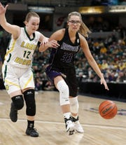 Northwestern Tigers Madison Layden (33) drives on Benton Central Bison Kennedy Tolen (12) in the second half of the IHSAA Girls Basketball Class 3A State Championship game at Bankers Life Fieldhouse on Saturday, Feb 23, 2019.