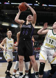 Northwestern Tigers Kendall Bostic (44) puts up a shot over Benton Central Bison Kennedy Tolen (12) in the second half of the IHSAA Girls Basketball Class 3A State Championship game at Bankers Life Fieldhouse on Friday, Feb 23, 2018.