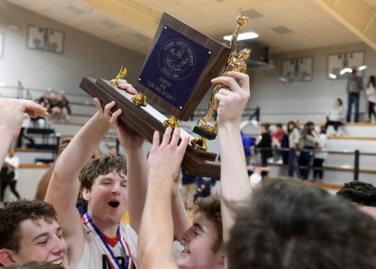 Madison-Ridgeland Academy players celebrate with the Academy 4A-Divison I trophy after defeating Jackson Academy 57-39 Saturday, February 23, 2019, at Madison-Ridgeland Academy.