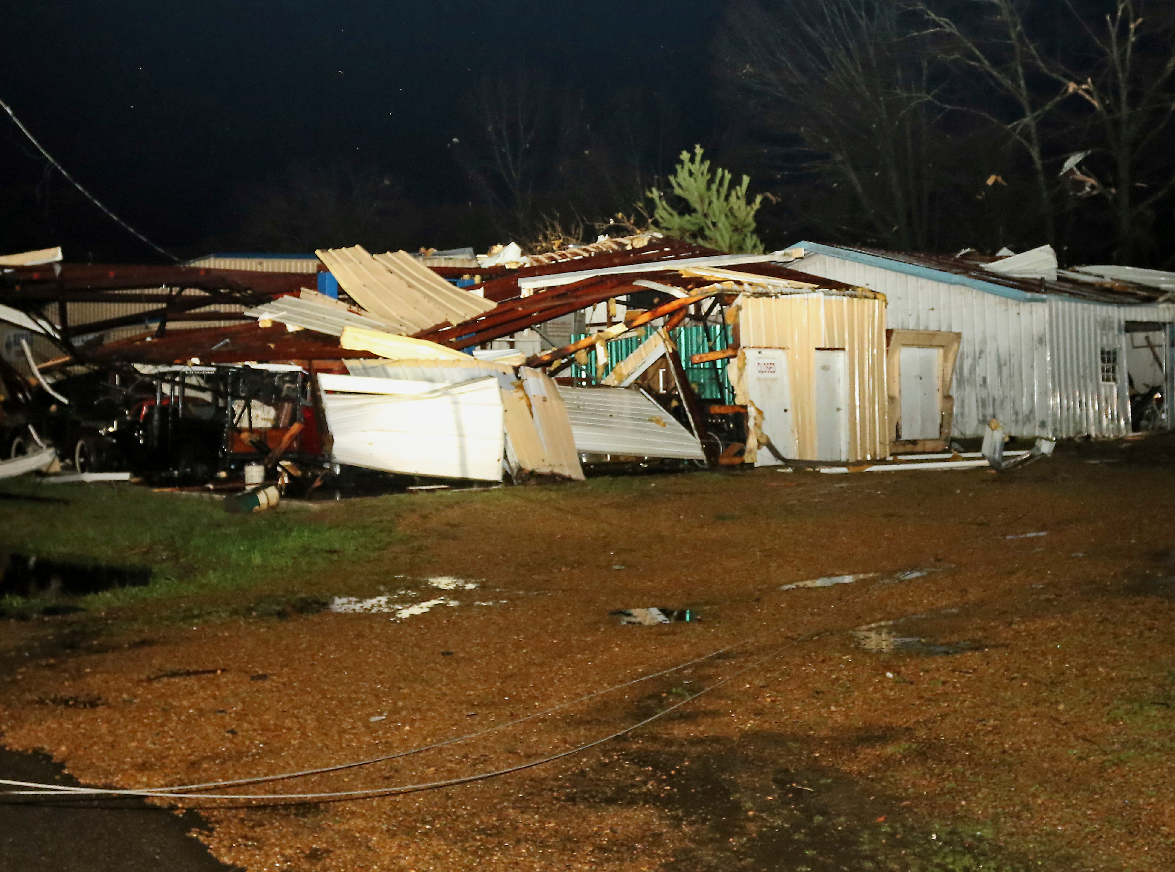 A building belonging to Lawrence Motors along Highway 50 in Columbus, Miss. is destroyed by a tornado on Saturday, Feb. 23, 2019. The building housed several antique cars. (AP Photo/Jim Lytle)