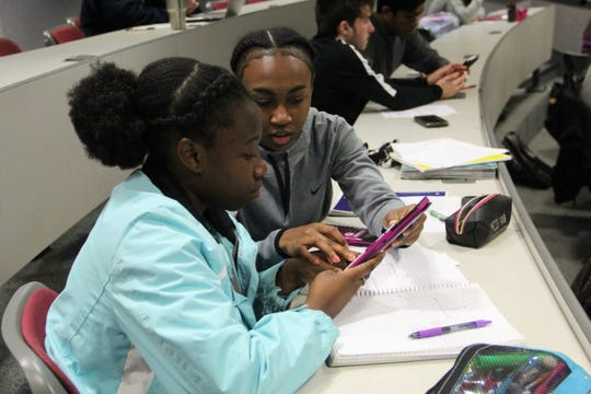 Mississippi School for Math and Science students Violet Jira and Faith Brown work on a problem about enzyme kinetics in biology class at the school in Columbus, Mississippi, on Oct. 17, 2018.