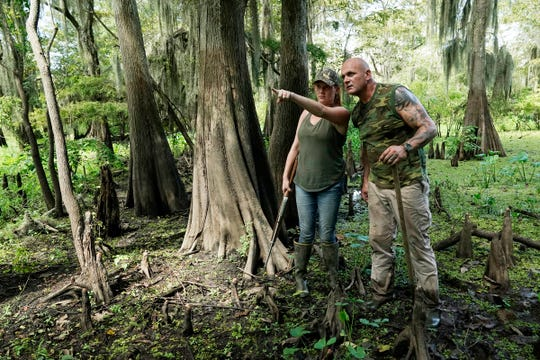 Ashley Jones of Brandon met Ronnie Adams of New Orleans on a hog hunt and now the two are cast members of Swamp People.