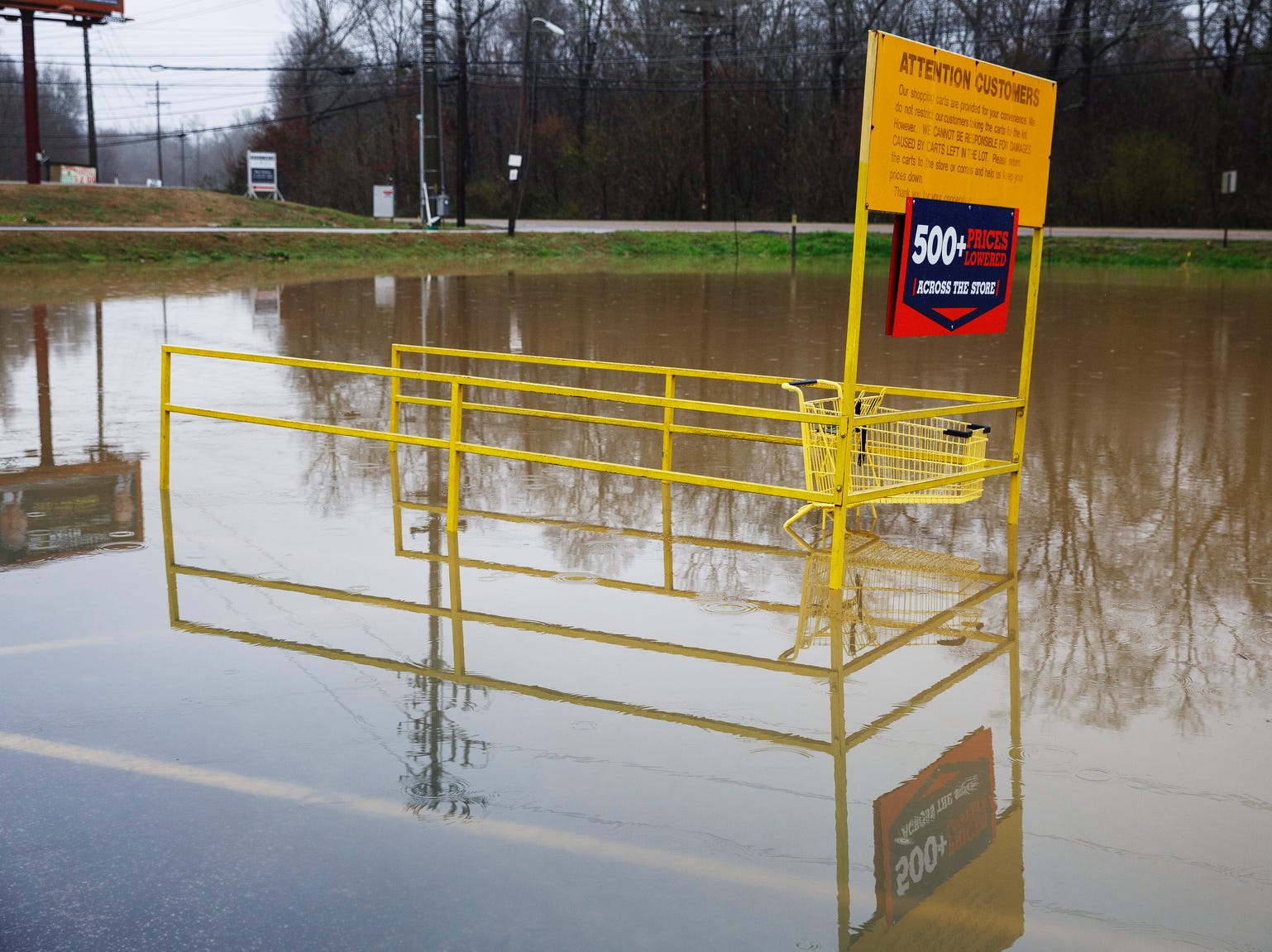 Middle Valley Plaza is seen flooded in Soddy-Daisy, Tenn., Saturday, Feb. 23, 2019, after heavy rain overnight. Homes, highways, parks and bridges throughout the South have been flooded or rendered out of commission Saturday, as the toll of days of drenching rains swelled waterways and pooled over saturated lands amid the threat of severe storms. (Doug Strickland/Chattanooga Times Free Press via AP)
