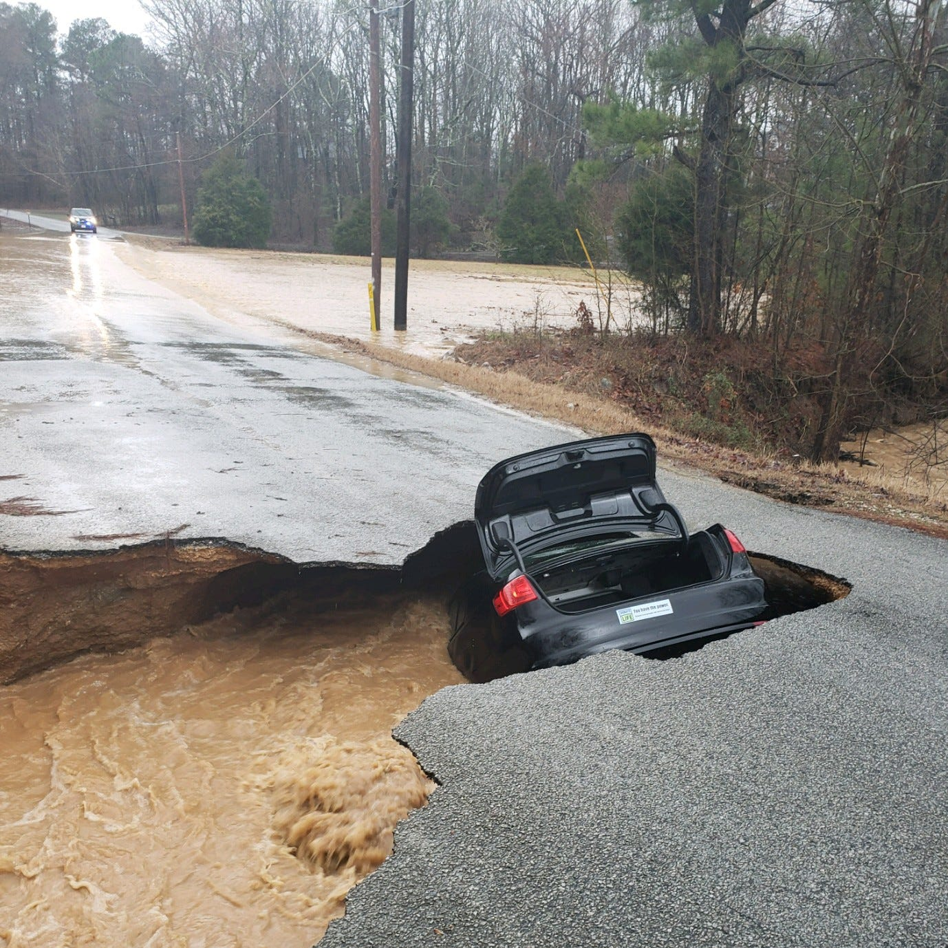 Sink hole swallows car between Milan and Medina
