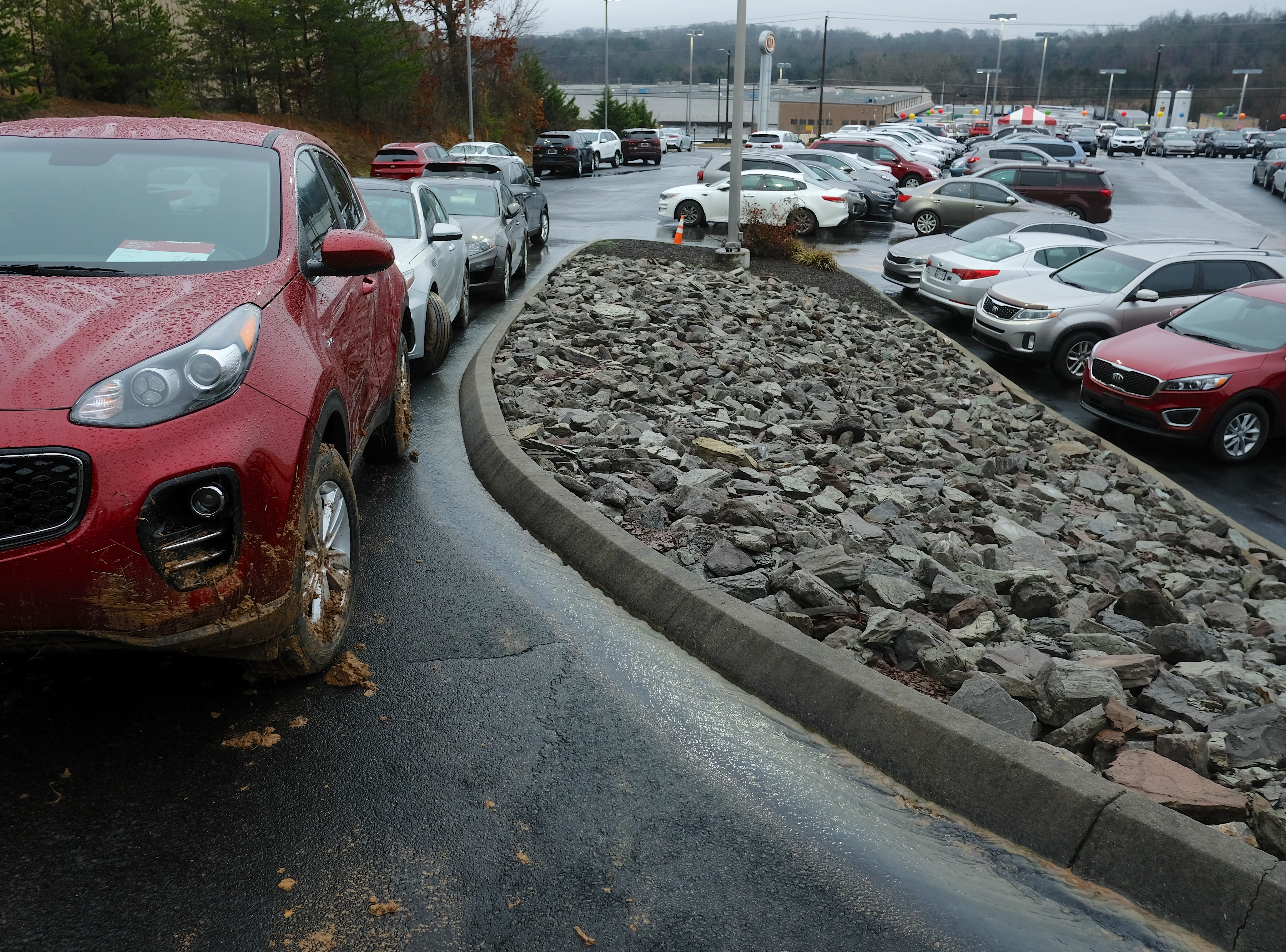 Car damage is visible from a mudslide that happened at Rusty Wallace Kia of Knoxville on Saturday, February 23, 2019, in Knoxville, Tenn. General manager Jake Bull reports an estimated damage of 30 new vehicles at his lot due to the mudslide.