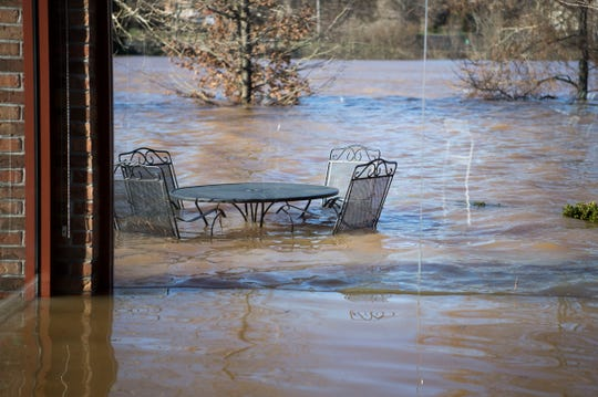 Flood damage is visible at Hunter Valley Farm's pavilion Sunday, Feb. 24, 2019.