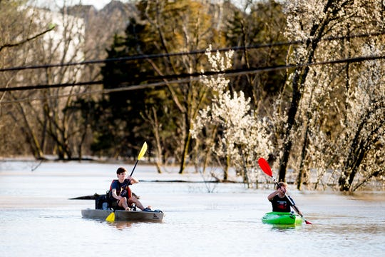 Truman Douglass and James Webster, both from Knoxville, kayak to the Sunoco on Ebenezer Road and Gleason Drive in Knoxville, Tennessee on Sunday, February 24, 2019.