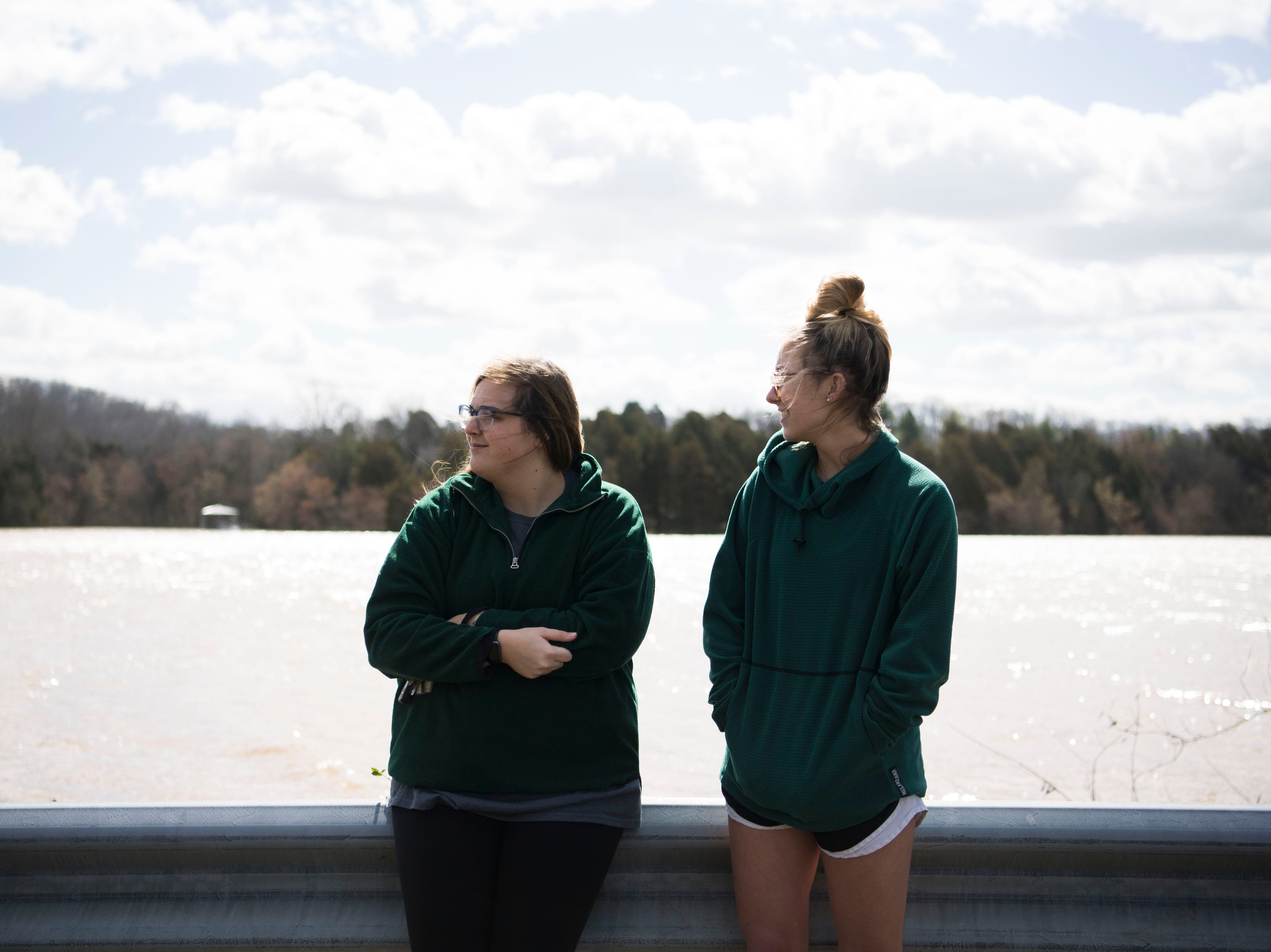 Molly Schaefer and Ansley Pacetti, both of Knoxville watch as their friend Julia Bryant, 18, canoes to her home which was surrounded by flood waters off Lantair Farm Lane, from South Northshore Drive in Southwest Knox County Sunday, Feb. 24, 2019.