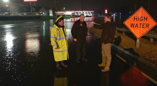 Knox County Commissioner Larsen Jay with members of the Knox County Sheriff's Office, assessing flood damage on Saturday, Feb. 23, 2019.