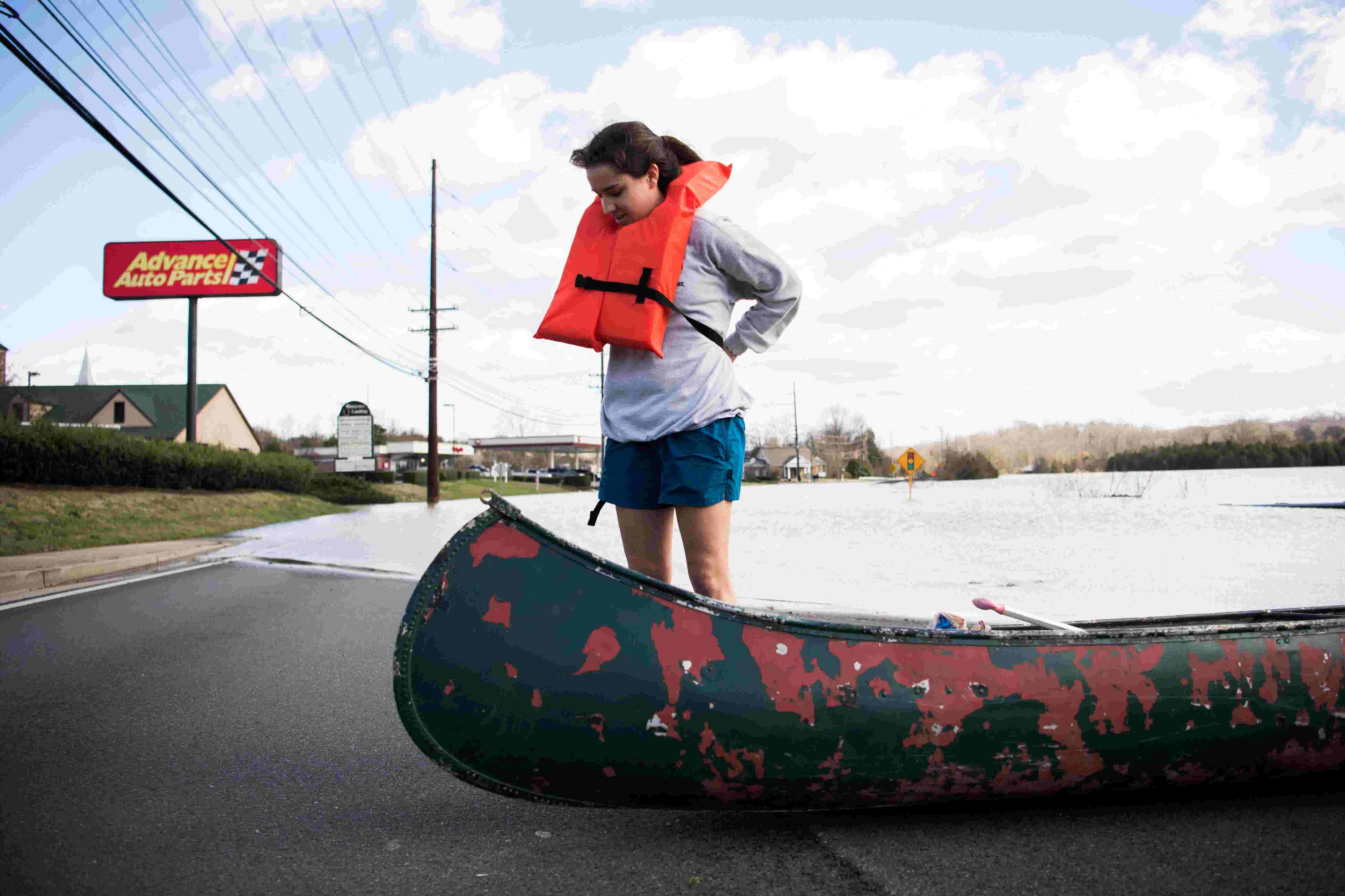 Bearden High senior canoes home through flood waters