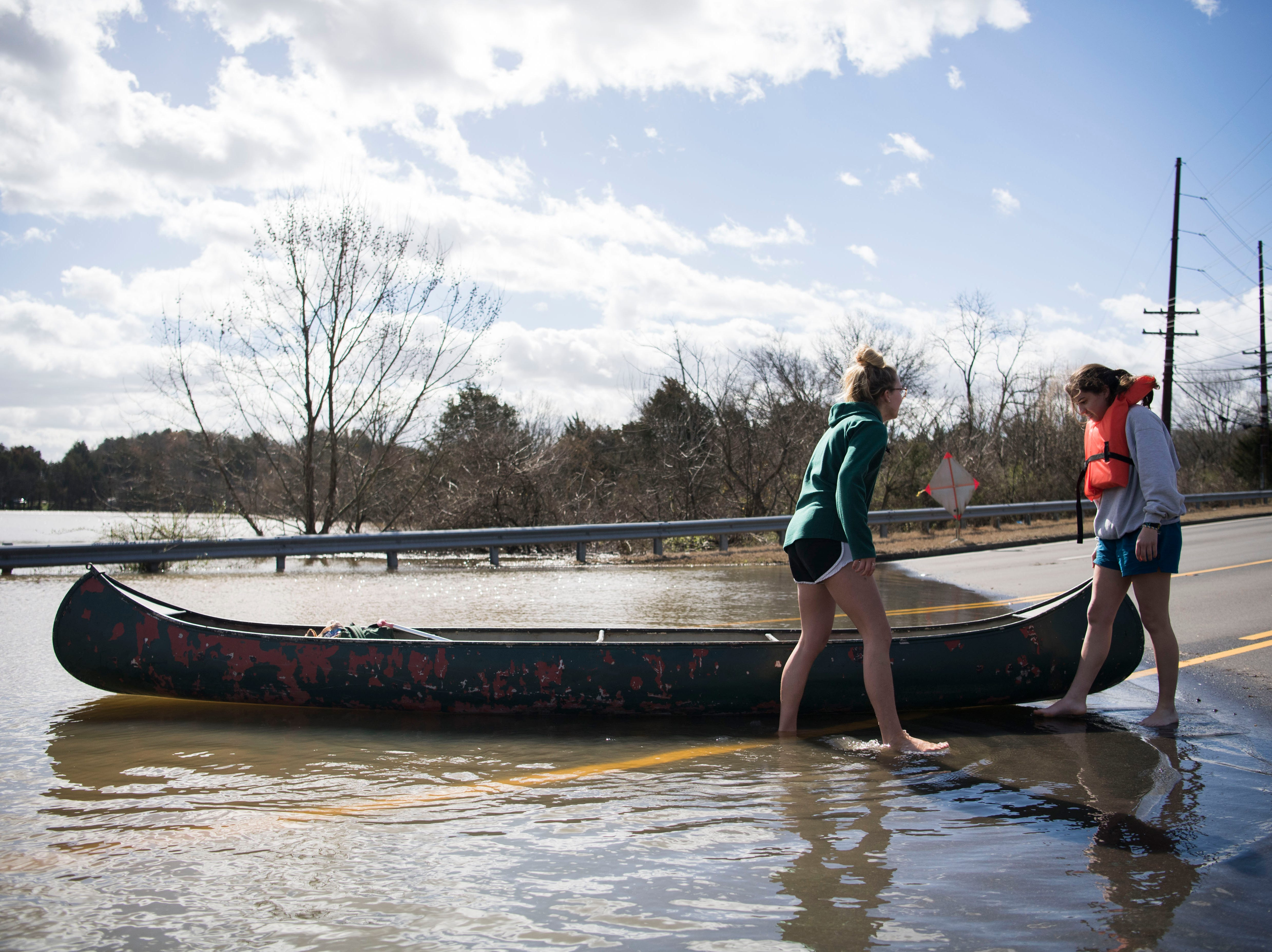 From left Ansley Pacetti, 18, and Julia Bryant, 18, prepare Bryant to canoe into flood waters on South Northshore Drive in Southwest Knox County Sunday, Feb. 24, 2019. Bryant canoed to her home which was surrounded by flood waters off Lantair Farm Lane, approximately three-quarters of a mile away.
