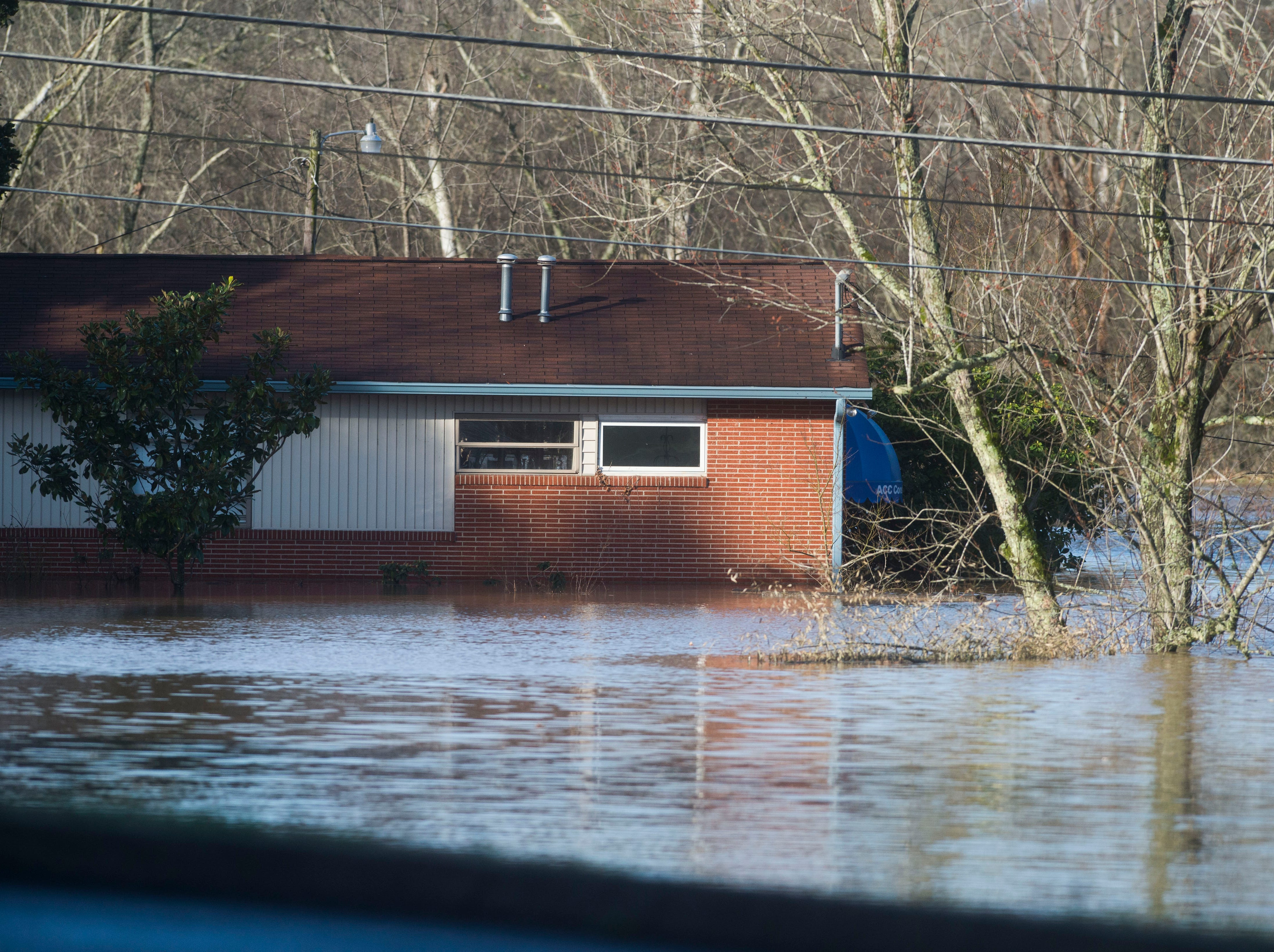 A flooded building on South Peters and Ebenezer Road in West Knoxville Sunday, Feb. 24, 2019.