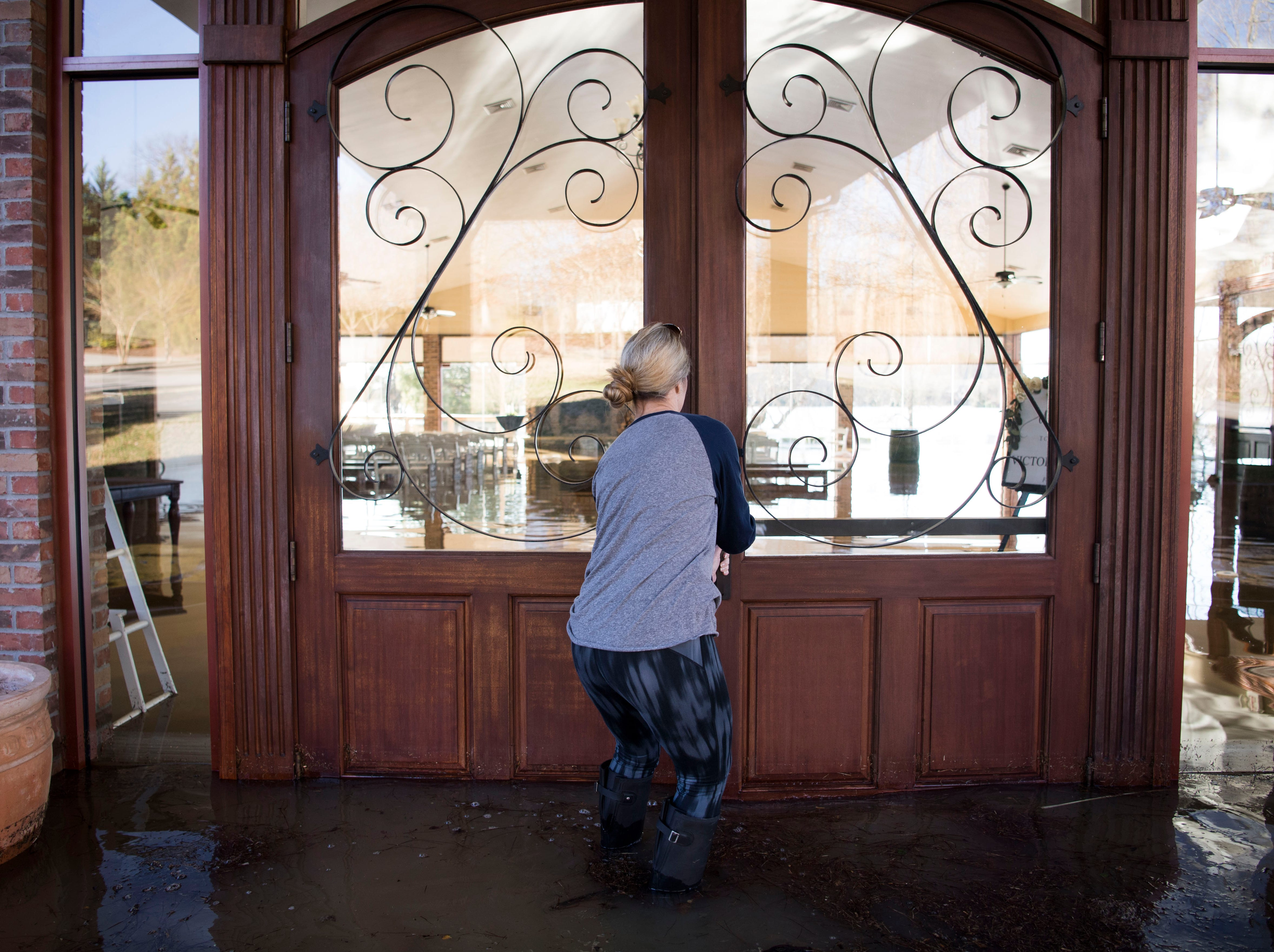 Nacy Barger opens the doors to the pavilion at Hunter Valley Farms, Sunday, Feb. 24, 2019.