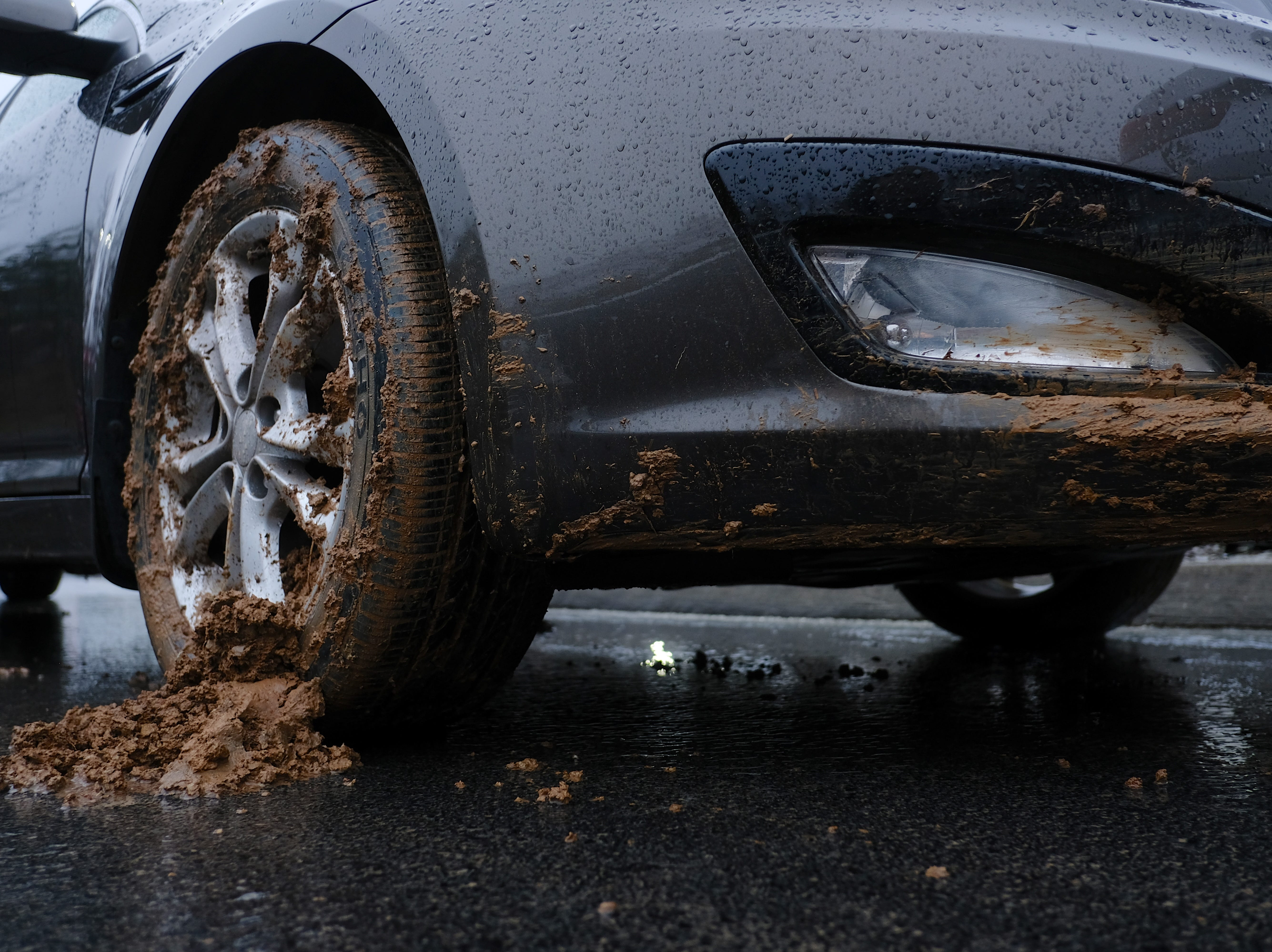 Thick coats of mud and damage is visible from a mudslide that happened at Rusty Wallace Kia of Knoxville on Saturday, February 23, 2019, in Knoxville, Tenn. General manager Jake Bull reports an estimated damage of 30 new vehicles at his lot due to the mudslide.