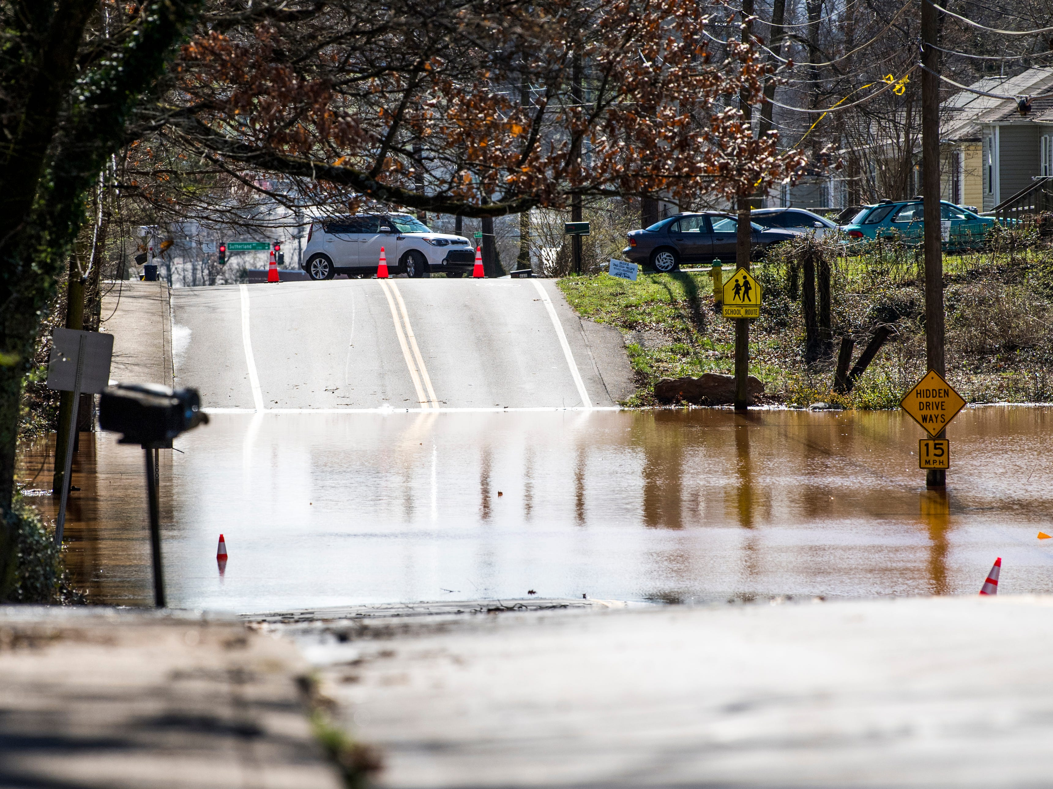 Cars turn around as water continues to flood portions of Hollywood Road in Knoxville around noon time on Sunday, February 24, 2019.