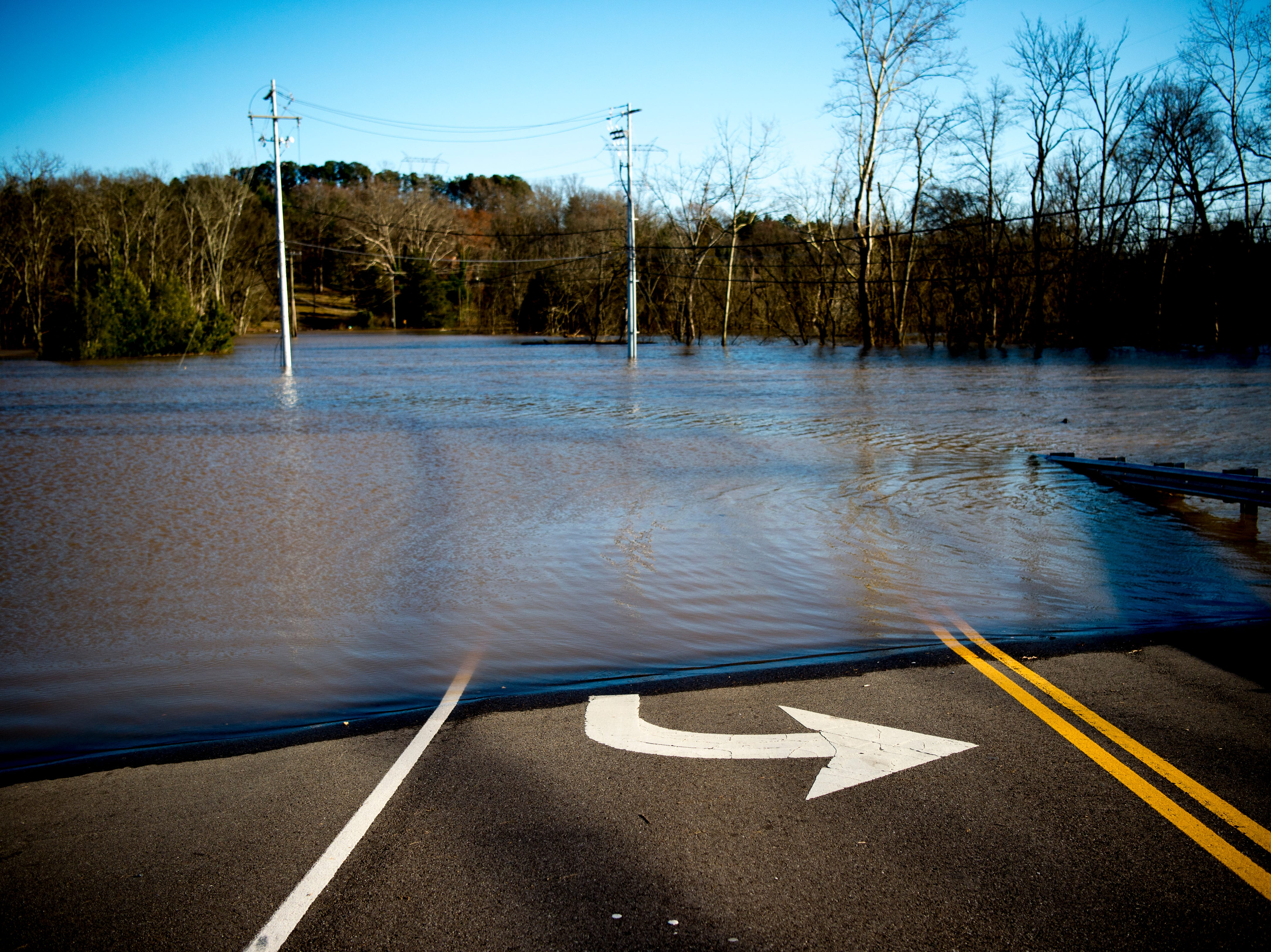 Water levels are seen near the Sunoco on Ebenezer Road and Gleason Drive in Knoxville, Tennessee on Sunday, February 24, 2019.