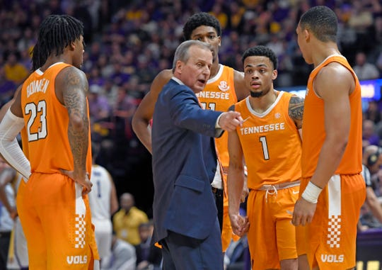 Tennessee  coach Rick Barnes talks with his players, from left, Jordan Bowden (23), Kyle Alexander (11), Lamonte Turner (1) and Grant Williams (2) during a timeout in the second half against LSU on Feb. 23, 2019, in Baton Rouge, La.