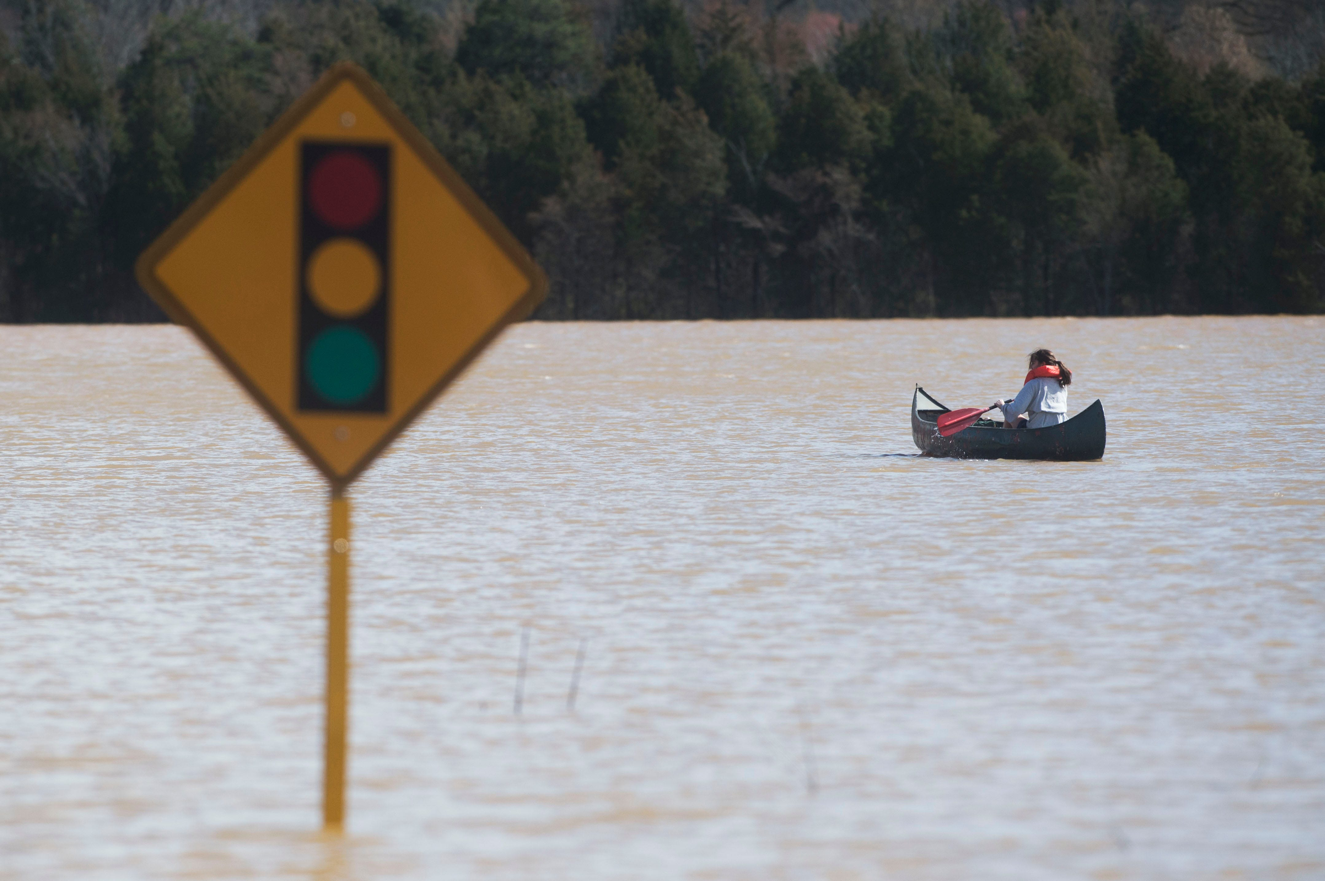 Julia Bryant, 18, of Knoxville, is seen canoeing in flood waters to her home which was surrounded by flood waters off Lantair Farm Lane, in Southwest Knox County Sunday, Feb. 24, 2019. Bryant canoed approximately three-quarters of a mile.