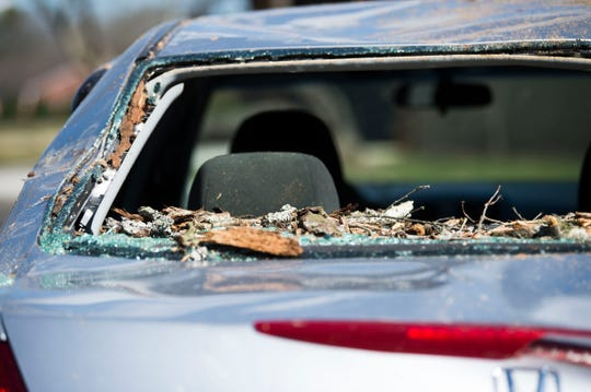 A car is damaged by a tree which fell during a church service at Fellowship Church Knoxville on Middlebrook Pike Sunday, Feb. 24, 2019. Over twenty cars were affected by the fallen tree.