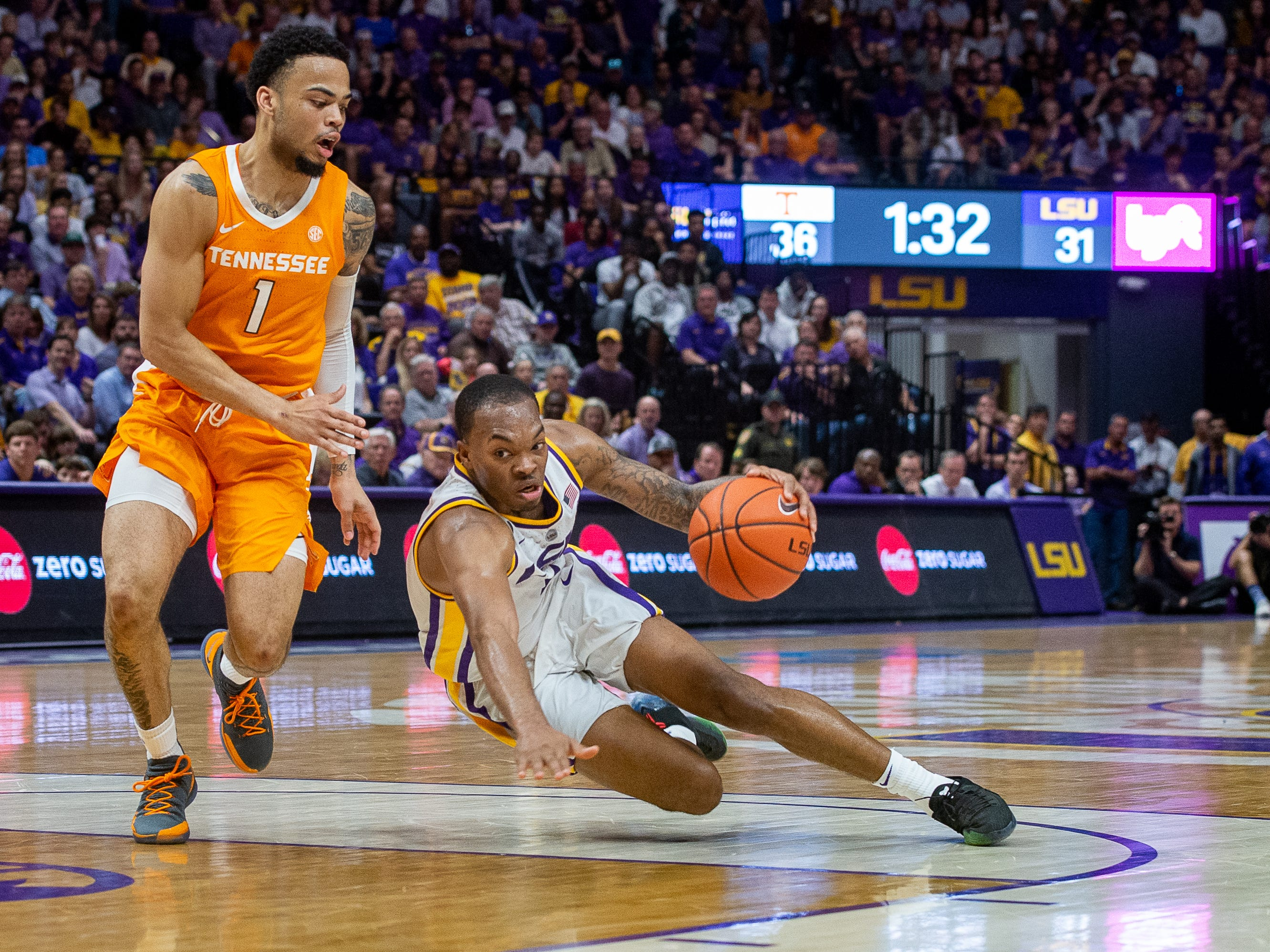 Javonte Smart falls while driving to the basket and Lamonte' Turner leaps over him as the LSU Fighting Tigers take on the Tennessee Volunteers at the Pete Marovich Assembly Center. Saturday, Feb. 23, 2019.