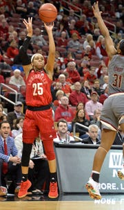 Louisville guard Asia Durr (25) shoots over the defense of Boston College guard Sydney Lowery (31) during the second half of an NCAA college basketball game in Louisville on Sunday, Feb. 24, 2019. Louisville won 87-51.