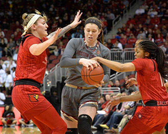 Boston College forward Emma Guy (11) is trapped by Louisville forward Sam Fuehring (3), left\, and guard Arica Carter (11) during the first half of an NCAA college basketball game in Louisville on Sunday, Feb. 24, 2019.