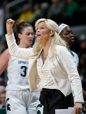 Michigan State coach Suzy Merchant gives instructions against Michigan during the third quarter of an NCAA college basketball game, Sunday, Feb. 24, 2019, in East Lansing, Mich. Michigan State won 74-64.