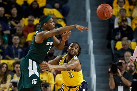 Michigan's Xavier Simpson, right, is one of four Michigan players on this summer's Moneyball Pro-Am rosters.