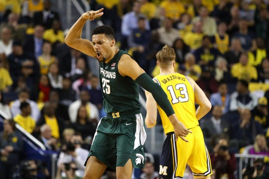 Kenny Goins reacts after a hitting a 3-pointer during MSU's win at Michigan on Feb. 24. He scored 16 points in the game.