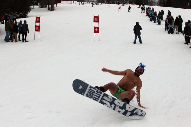Austen Hammett falls into the snow during the annual Chippendale race at the Snow Trails Saturday afternoon.