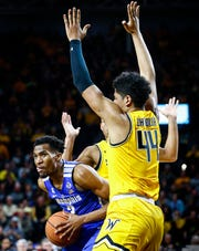 Memphis guard Jeremiah Martin (left) drives the lane against Wichita State's Isaiah Poor Bear-Chandler (right) on Saturday.