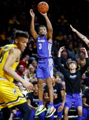 Memphis guard Jeremiah Martin (middle) hits a 3-pointer against the Wichita State defense during action Wichita, Kansas, Saturday, February 23, 2019.