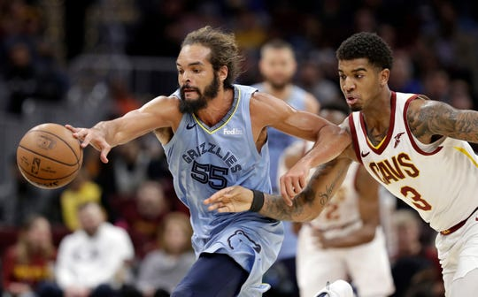 The Grizzlies' Joakim Noah (55) and the Cavaliers' Marquese Chriss (3) battle for a loose ball in the first half of Saturday's game.