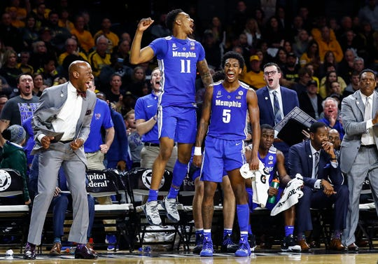 The Memphis bench celebrates during the final minutes of an 88-85 victory over Wichita State on Saturday.