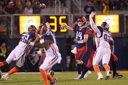 Memphis Express quarterback Christian Hackenberg (14) throws a pass against the Orlando Apollos during an AAF football game, Saturday, Feb. 23, 2019, at Spectrum Stadium in Orlando, Fla.